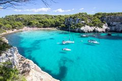 Boats and yachts on Macarella beach, Menorca, Spain. Panorama view of Macarella beach in Menorca, Balearic Islands, Spain Stock Photos