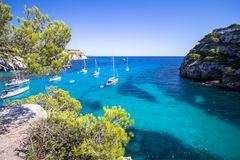 Boats and yachts on Macarella beach, Menorca, Spain Stock Photography