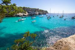 Boats and yachts on Macarella beach, Menorca, Spain. Panorama view of Macarella beach in Menorca, Balearic Islands, Spain Royalty Free Stock Photography