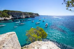 Boats and yachts on Macarella beach, Menorca, Spain. Panorama view of Macarella beach in Menorca, Balearic Islands, Spain Stock Image