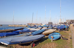 Boats and yachts and masts. Photo of whitstable harbour showing boats and masts and yachts on beach royalty free stock photo