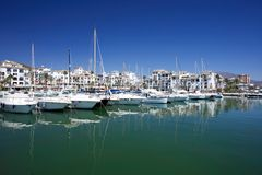 Boats and yachts moored in Duquesa port in Spain on the Costa de royalty free stock photo