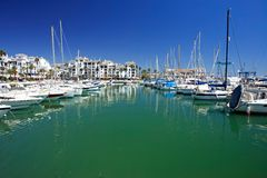 Boats and yachts moored in Duquesa port in Spain on the Costa de royalty free stock photography
