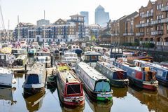 Boats and yachts moored at Limehouse Basin Marina. London, UK - April 8, 2017 - Boats and yachts moored at Limehouse Basin Marina with Canary Wharf in the Stock Images