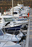 Boats and yachts moored in a marina. Motorboats and yachts moored in a marina royalty free stock photography