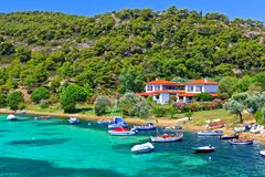 Boats and yachts moored near the villa in a secluded location. On the Aegean sea Royalty Free Stock Photography