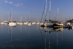 Boats and yachts moored at the port. Stock Photo