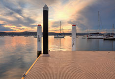 Boats and yachts moored at sunset Royalty Free Stock Image