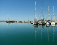 Boats and yachts in the port. On the background of city Royalty Free Stock Image