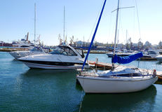 Boats and Yachts, standing on the shore in the port Stock Photo