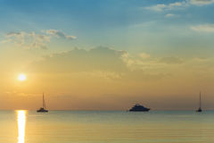 Boats and yachts at sunset Stock Photography