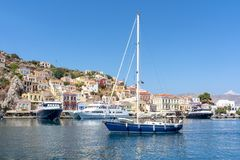 Boats and yachts in Symi port, Dodecanese islands, Greece stock images
