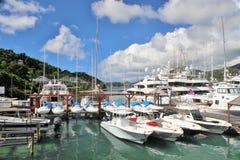 Boats and yahts docked - December 4, 2016 - boast and yachts docked at a Marina on the island of Antigua. Boast and yachts docked at a Marina on the island of Stock Photo