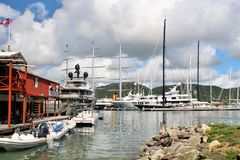 Boats and yahts docked - December 4, 2016 - boast and yachts docked at a Marina on the island of Antigua. Boats and yachts docked at a Marina on the island of stock photos