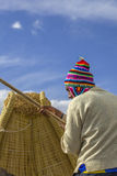 Boatsman on reed boat in Peru Royalty Free Stock Images