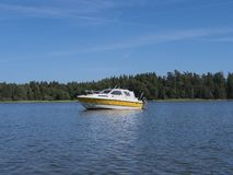 A small boat on a lake stock photos