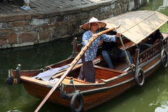 A boatwoman transports tuorists in her traditional wooden boat i Royalty Free Stock Photography