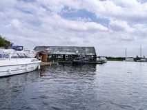 Boatyard on riverside. This one by Ludham Bridge on the Norfolk Broads, England Stock Image