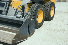 Bob Cat. Small industrial machine with focus on the wheels and loader Royalty Free Stock Photo