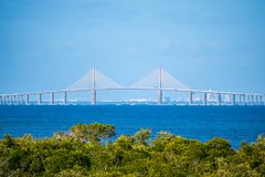 The Bob Graham Sunshine Skyway Bridge in Brandeton, Florida. The view of Skyway, cable-stayed bridge from the Robinson Nature Preserve stock image