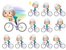 Bob hair green wear women ride on rode bicycle Stock Photo