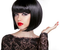 Bob hairstyle. Brunette fashion model with black short hair and Stock Images