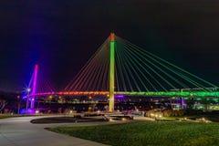 Free Bob Kerrey Pedestrian Bridge Omaha Nebraska At Night With Purple, Yellow And Green Lights Reflections In Missouri River. Royalty Free Stock Image - 164608046