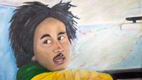 Bob Marley oil painting. An original oil painting of the late Jamaican Reggae singer Bob Marley. This painting was done by Felicity Thompson, a local artist in vector illustration