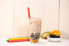 Boba / Bubble tea. Homemade Milk Tea with Pearls on wooden table.  stock photo