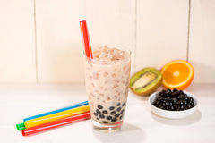 Boba / Bubble tea. Homemade Milk Tea with Pearls on wooden table.  stock images