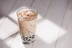 Boba / Bubble tea. Homemade Milk Tea with Pearls on wooden table Stock Images
