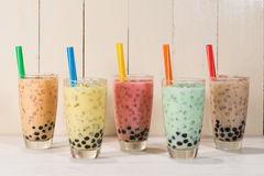Boba / Bubble tea. Homemade Various Milk Tea with Pearls on wood. En table stock image