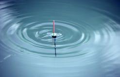 Bobber met horizontale golven Royalty-vrije Stock Foto