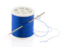 Bobbin with blue thread Royalty Free Stock Images
