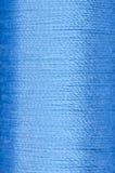 Bobbin of blue thread Stock Image