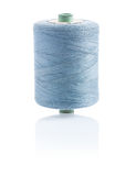 A bobbin with gray sewing string Stock Photography