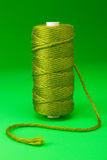 Bobbin of green thread Stock Photo