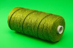 Bobbin of green thread Stock Image