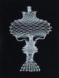 Bobbin lace. Handmade Slovak bobbin lace in shape of a girl Stock Photography