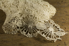 Bobbin Lace. Details & wood table royalty free stock image