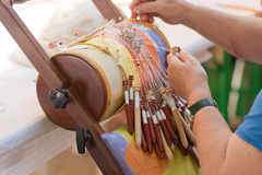 Bobbin lace-making. Skilled female hands at the traditional lace making crafts Stock Photos