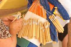 Bobbin lace-making. Skilled female hands at the traditional lace making crafts Stock Photo