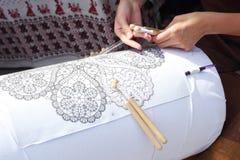 Bobbin lace making. Outdoors closeup royalty free stock images