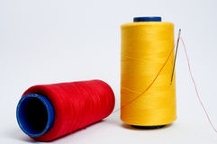 Bobbin and Needle. Red, Yellow Bobbin and Needle Royalty Free Stock Photos