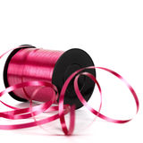 Bobbin of pink ribbon Stock Photo