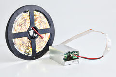 Bobbin shining LED strip light connected to a DC converter. Royalty Free Stock Image
