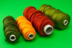 Bobbin of thread with colorful threads in a row Royalty Free Stock Photography
