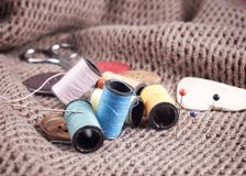 Bobbin of thread with needle and button Royalty Free Stock Photo