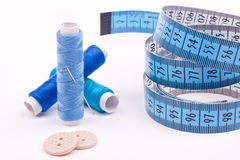 Bobbin thread with needle and buttons Stock Image