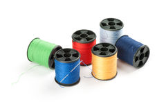 Bobbin threads with needle Royalty Free Stock Images
